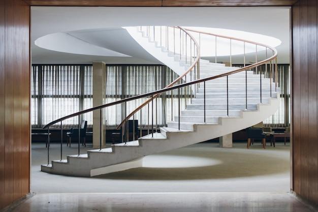 An elegant white staircase spirals upwards