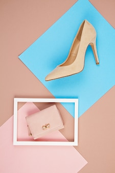 Elegant woman accessories hand bag and high heel shoes.