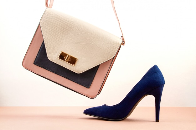 Elegant woman accessories, hand bag and high heel shoes.