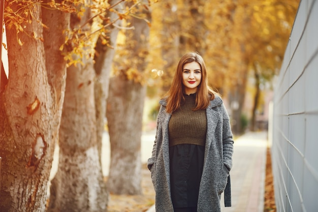 Elegant woman in a autumn city