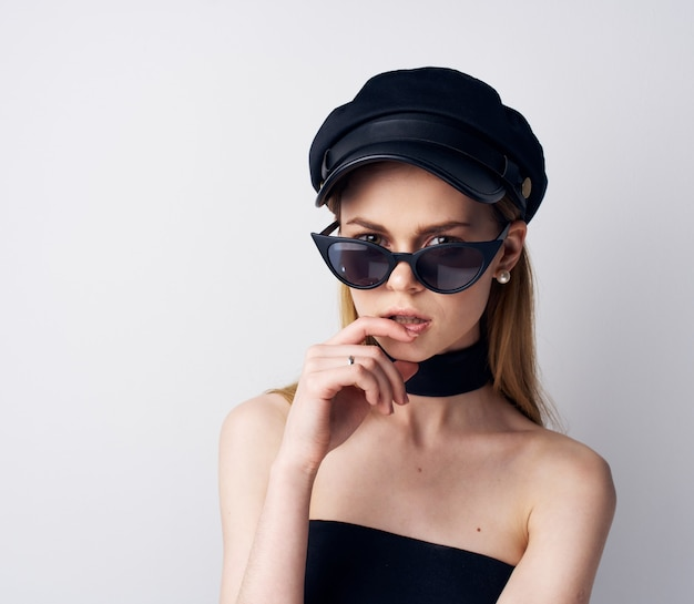 Elegant woman in black cap sunglasses evening dress glamor. high quality photo