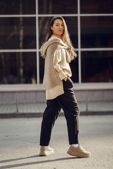 Elegant woman in a brown shirt in a spring city