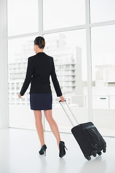 Elegant woman on a business trip