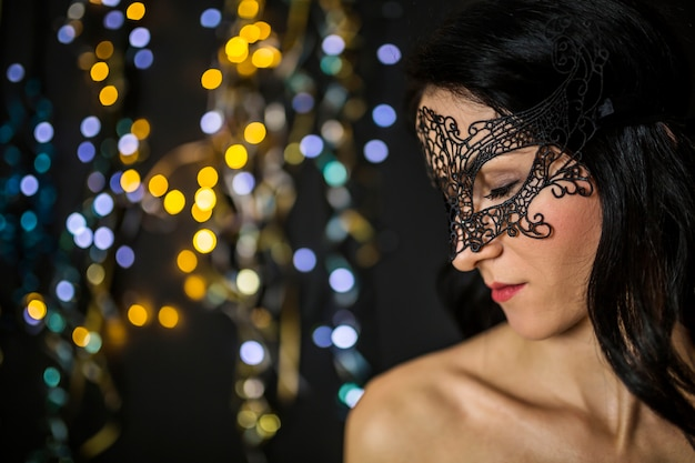 Elegant woman celebrating venetian carnival