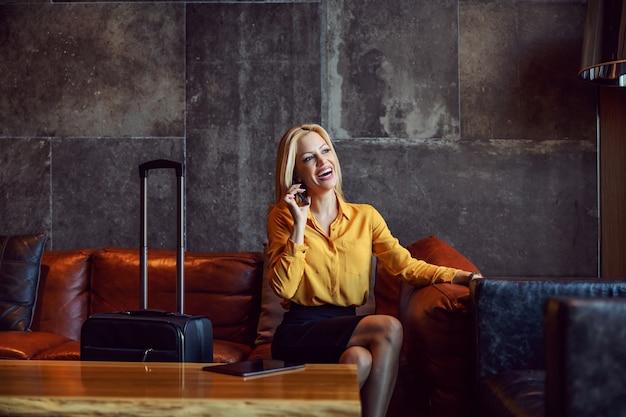 An elegant woman in hotel lobby