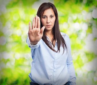 Elegant woman making a stop gesture