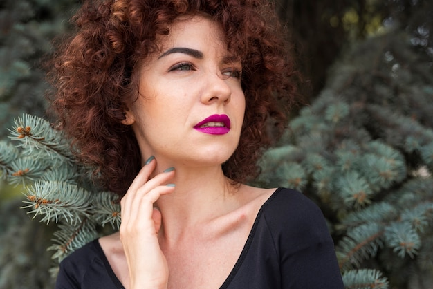 Elegant woman posing in outdoors