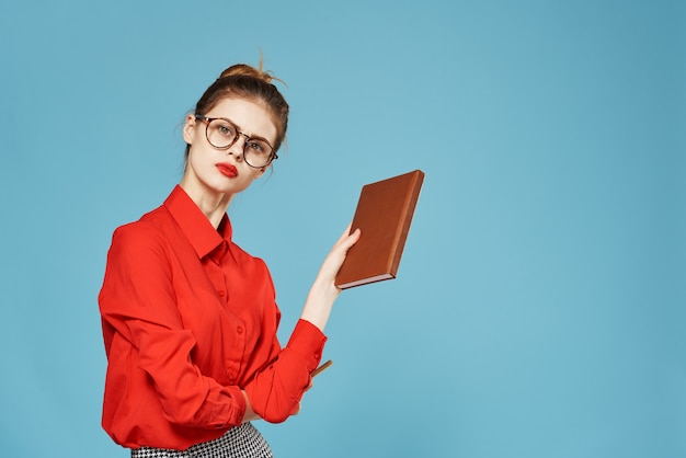 Elegant woman red shirt secretary official office notepad
