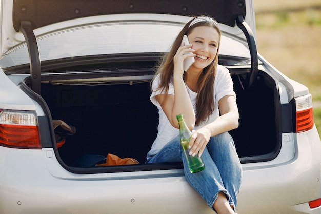 Elegant woman sitting in a trunk with water