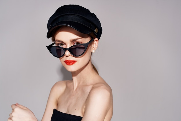 Elegant woman in sunglasses red lips fashionable luxury clothing. high quality photo