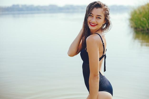 Elegant woman in a sunny beach