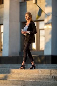 Elegant woman walking long shot