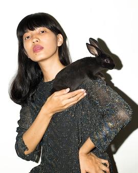 Elegant woman with black rabbit