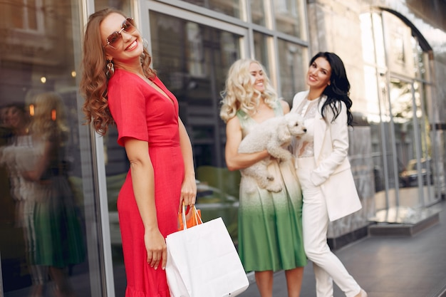 Elegant women with shopping bags in a city