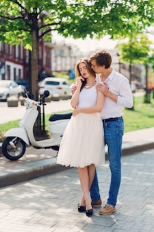 Elegant young couple in love hugging