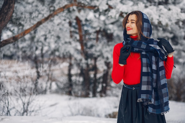 Elegant and young girl in a winter park