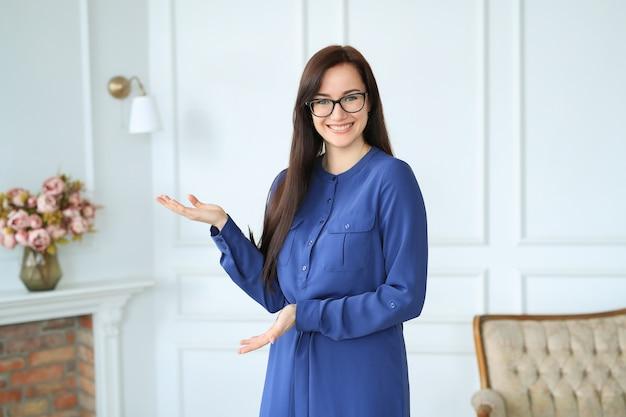 Elegant young woman posing at home