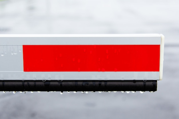 Element barrier in the parking lot for protection in rainy weather.