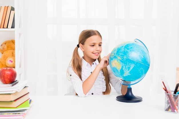 Elementary school girl with globe