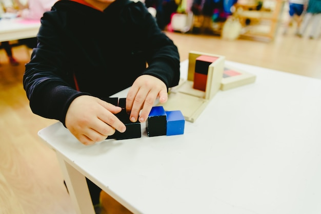Elementary students in a school using alternative education wood materials.