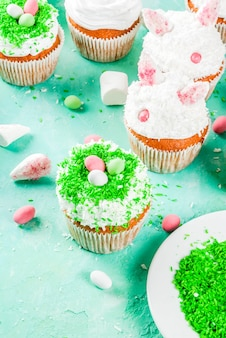 Elements to make easter cupcakes with bunny ears