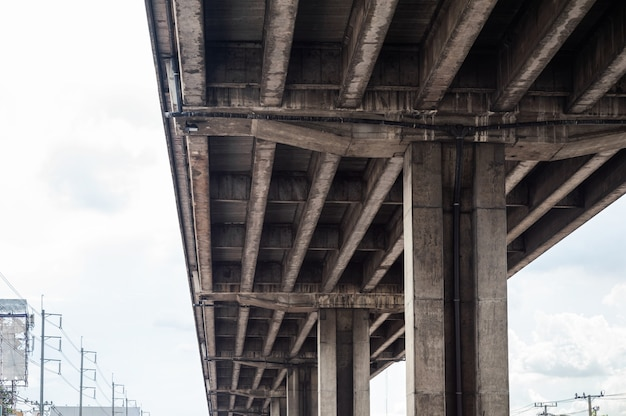 Below of elevated highway structure and concrete pillar in bangkok city