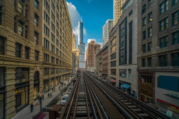 Elevated train tracks are running above the railroad tracks at the loop line at chicago