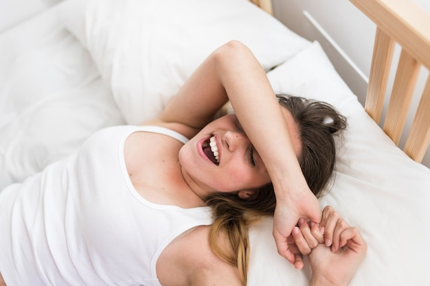 Elevated view of a beautiful woman sleeping on bed