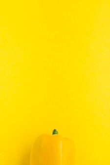 Elevated view of bell pepper on yellow background