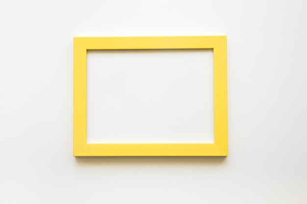 Elevated view of blank yellow frame on white background