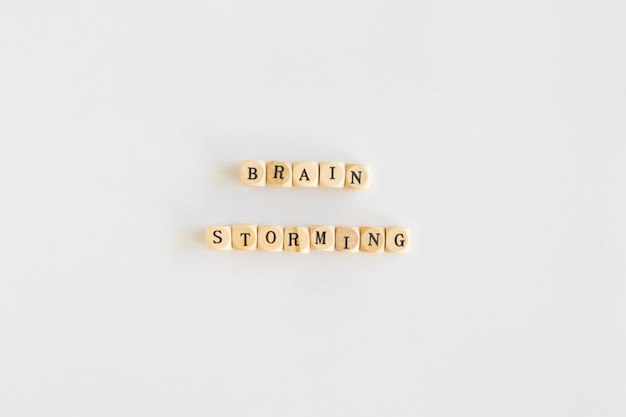 Elevated view of brainstorming wooden blocks on white background