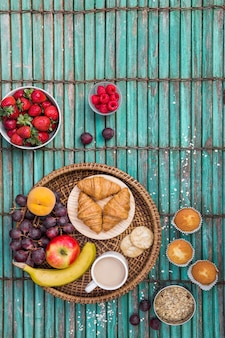 Elevated view of breakfast on striped wooden background