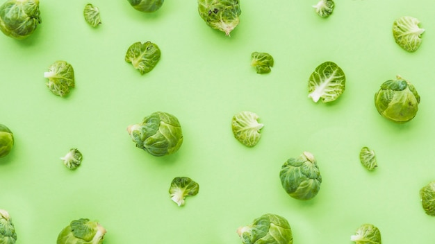 Elevated view of brussels sprouts on green backdrop