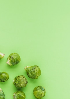 Elevated view of brussels sprouts on green surface