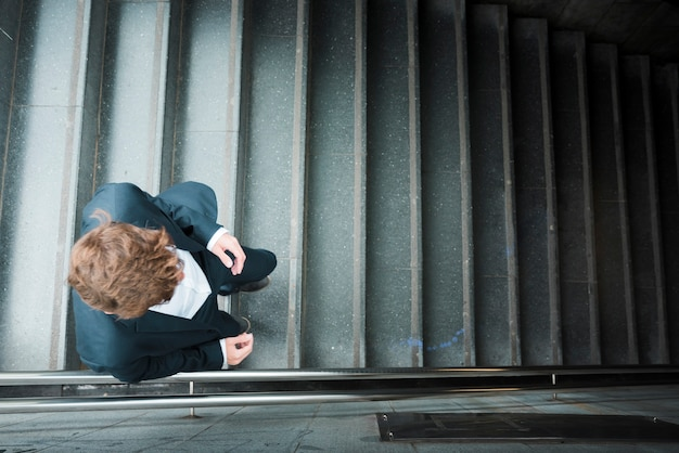 An elevated view of a businessman walking downstairs
