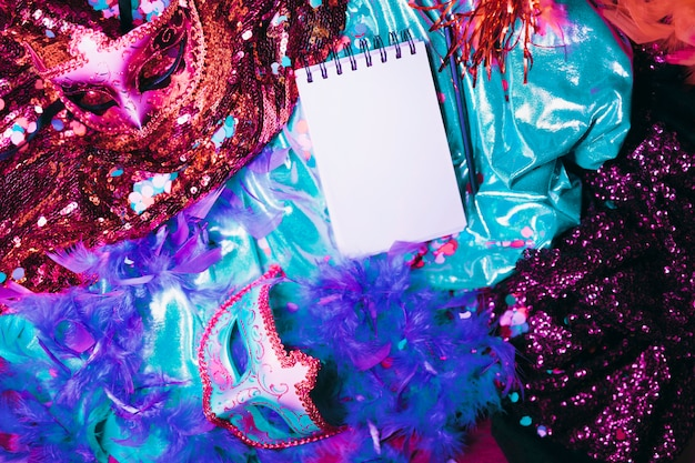 Elevated view of carnival props with blank spiral notepad