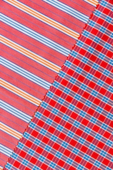 Elevated view of chequered and straight lines pattern textile