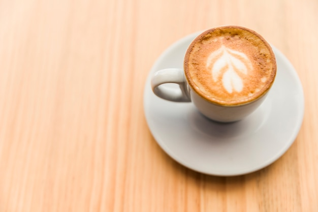 Elevated view of coffee latte on wooden surface