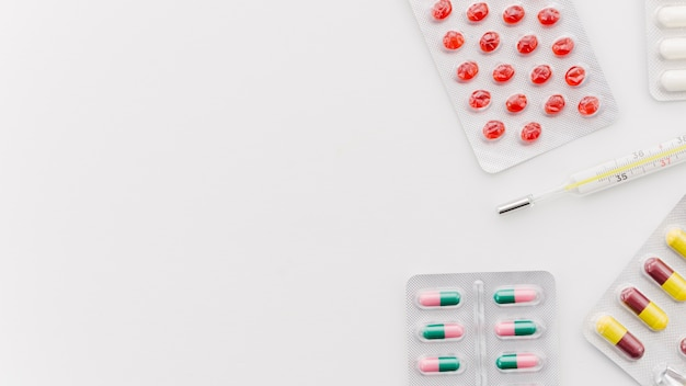 An elevated view of colorful pills on white background
