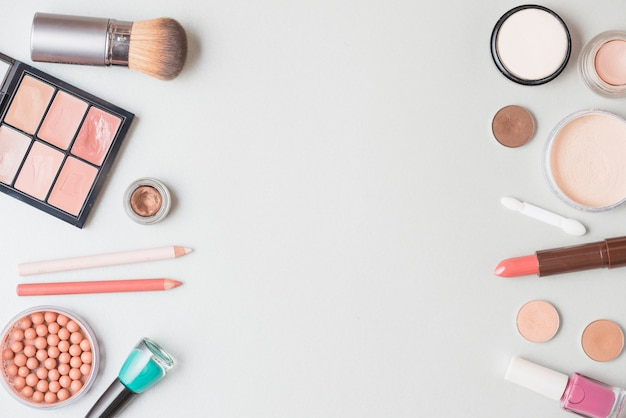 Elevated view of cosmetic products on white backdrop