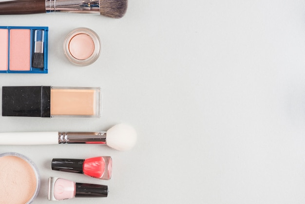 Elevated view of cosmetic products on white surface