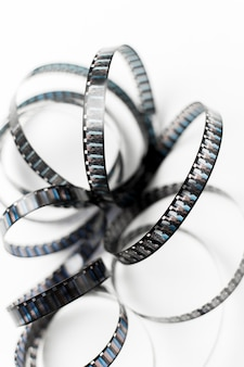 An elevated view of curve film stripe on white background
