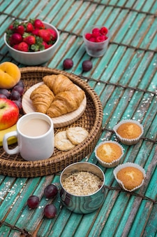Elevated view of delicious breakfast on wooden surface