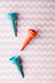 Elevated view of empty ice cream cone on textured background