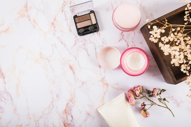 Elevated view of eye shadow powder and moisturizing cream