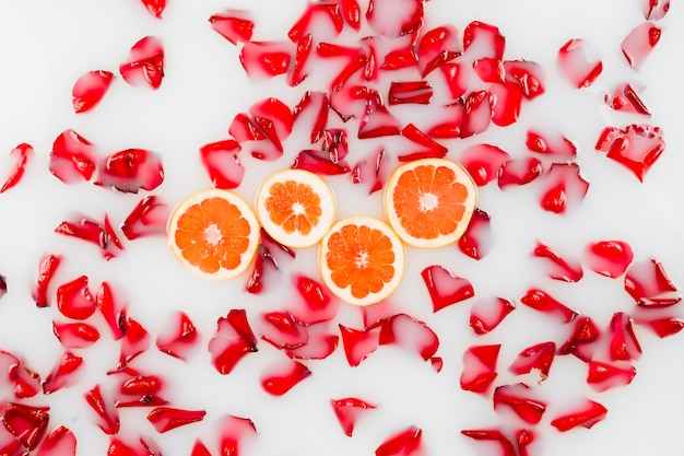 Elevated view of flower petals and grapefruit slices