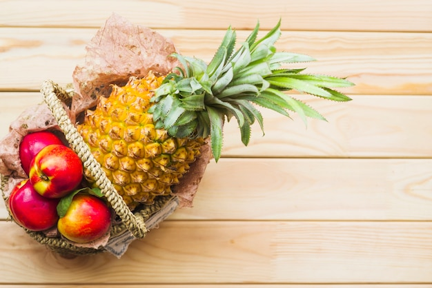 Elevated view of fresh fruits on wooden background