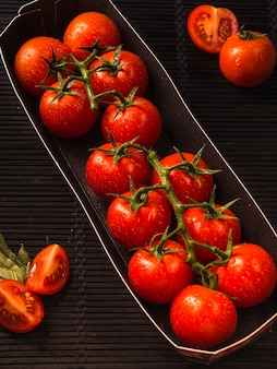 Elevated view of fresh red tomatoes in tray