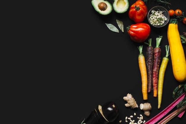 Elevated view of fresh vegetables on black backdrop