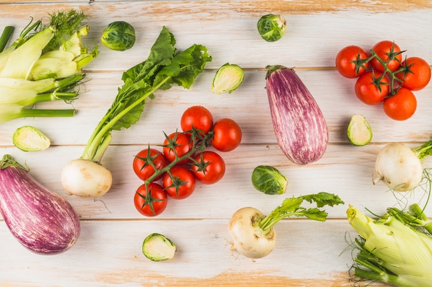 Elevated view of fresh vegetables on wooden background